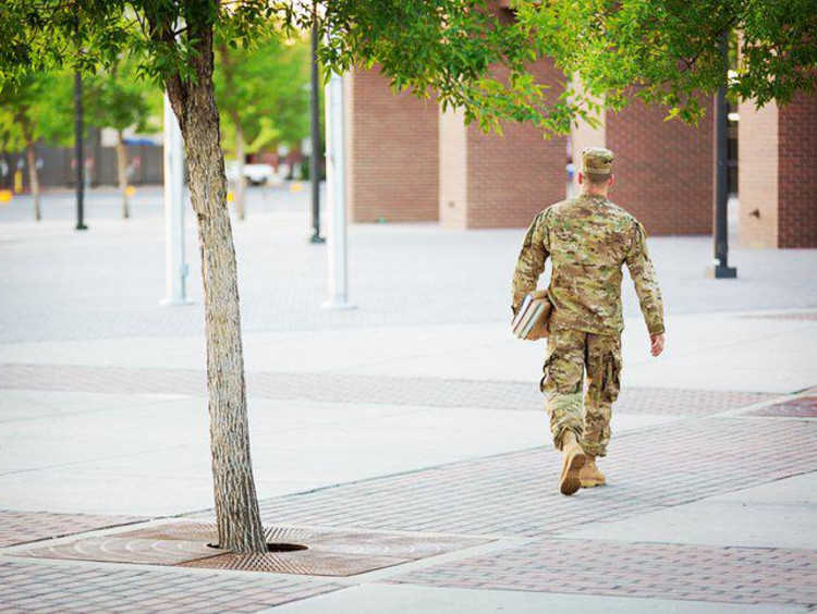 A man in military dress walking