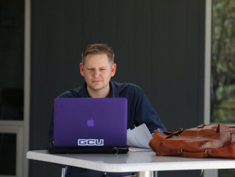 Doctoral learner working on a laptop