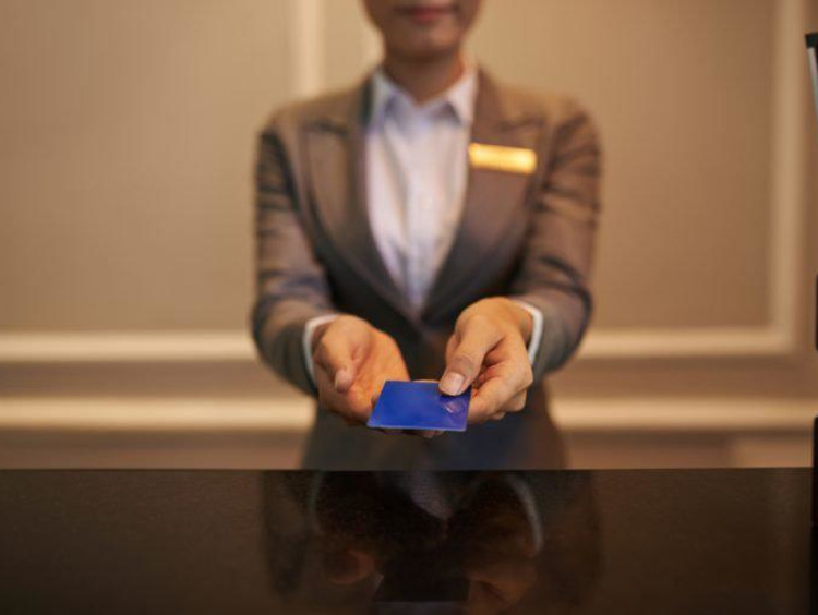 resort manager taking payment from guest