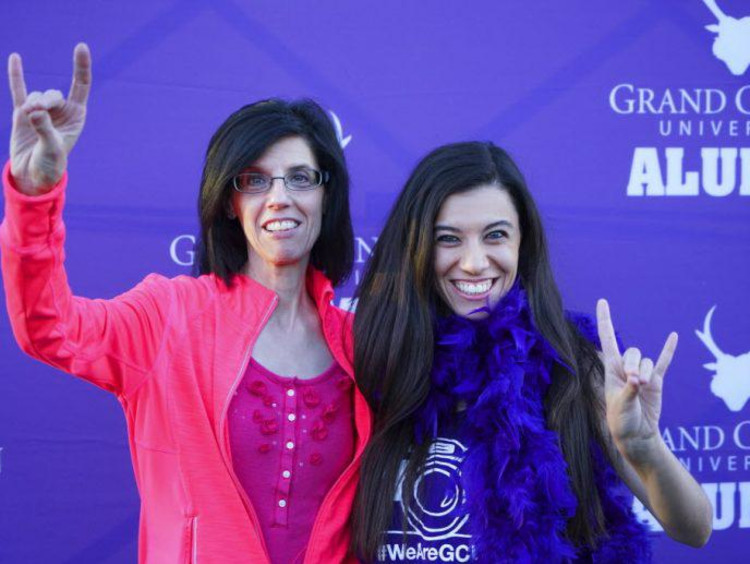 mom and student holding a lopes up