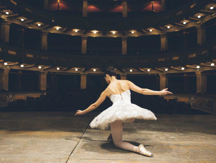 Ballerina taking a knee after a performance