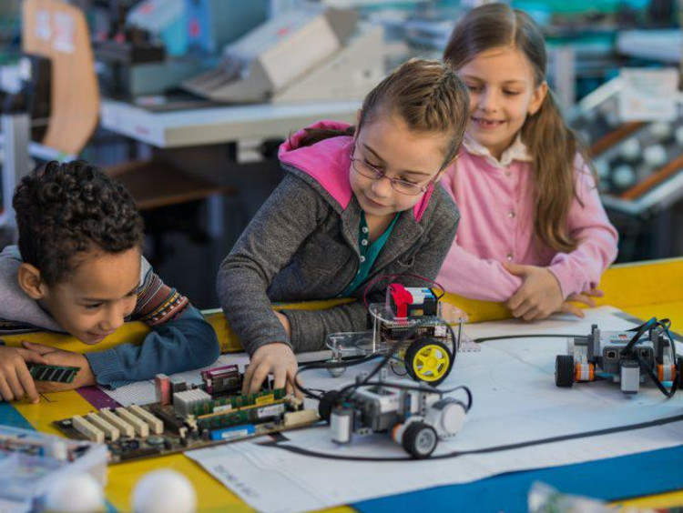 Young children working with robots