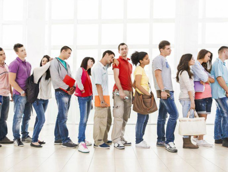 A group of people standing in a line
