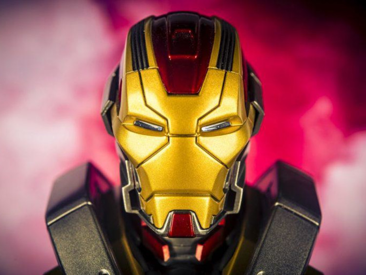 An Iron Man helmet surrounded by red smoke