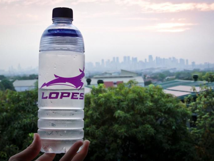 Lopes water bottle shows Philippines landscape in background
