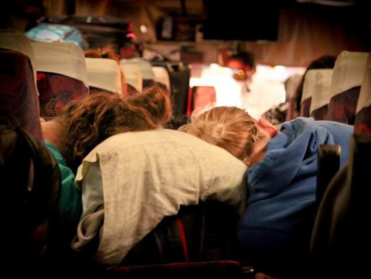 people asleep on a bus