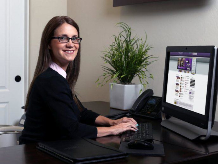 Female doctoral student browses the GCU website