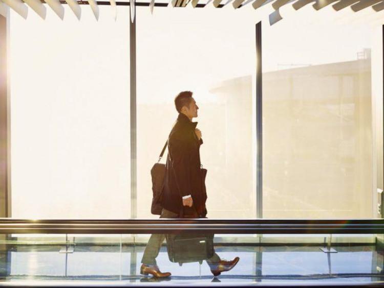 Businessman walks in airport terminal