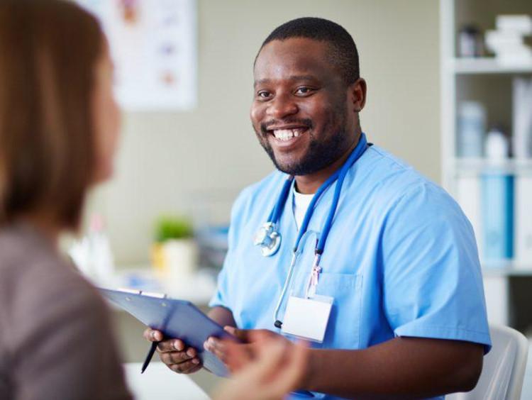 nurse talking with a patient