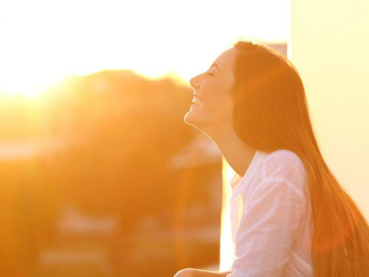 woman smiling in sunlight