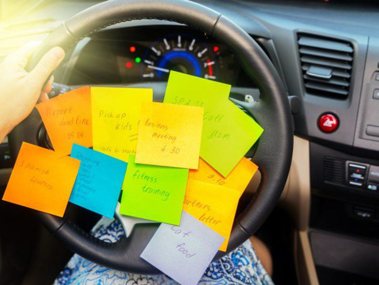 sticky notes on steering wheel