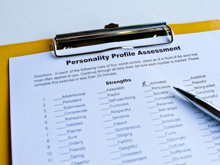 Personality profile assessment on a clipboard with an x next to one characteristic