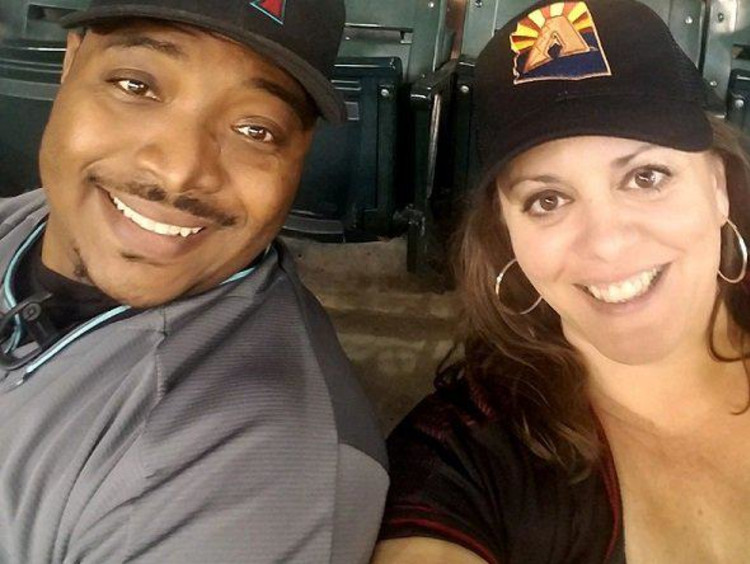 COE faculty member Katy Long and her husband at a Diamondbacks game