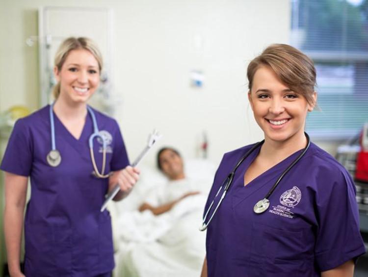 two GCU nurses with a patient