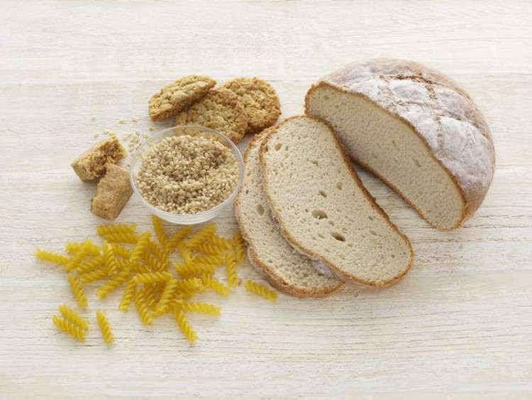 Bread and pasta on a wooden surface