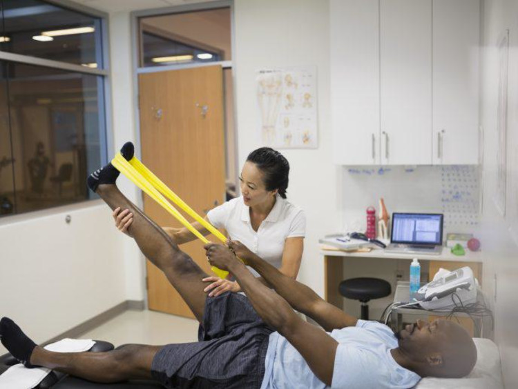 athletic trainer helping client