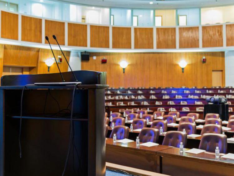 A podium in an empty auditorium