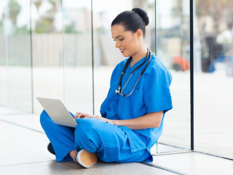 nurse using her laptop