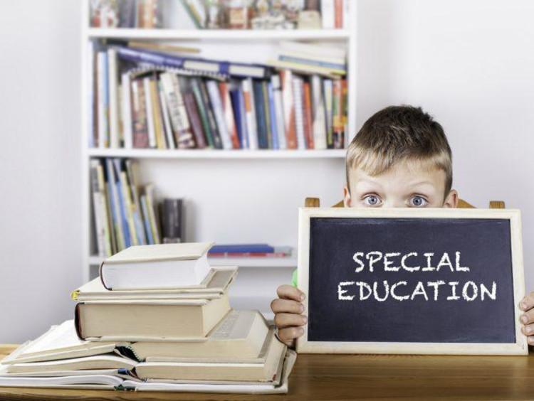 little boy with chalkboard