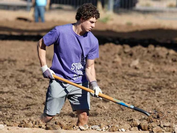 GCU Student doing yard work