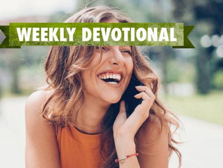 Weekly Devotional: Woman a cellphone smiling