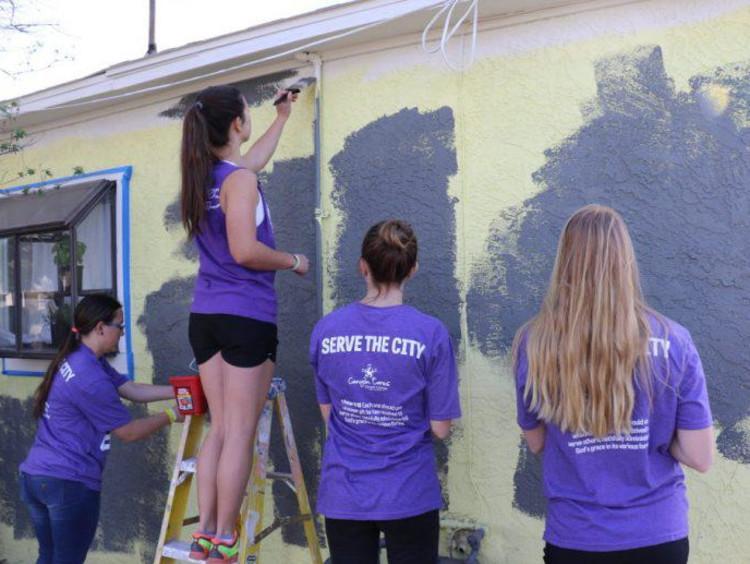 GCU students painting building