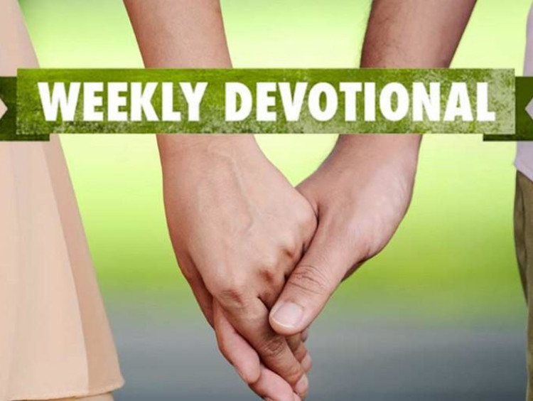 Two people holding hands under a weekly devotional banner