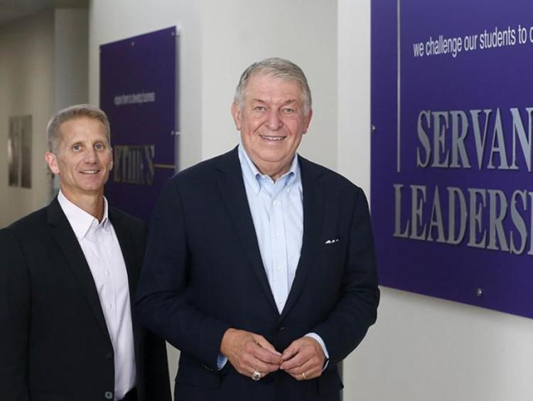 Dr. Gibb and Jerry Coangelo next to CCOB's Servant Leadership pillar