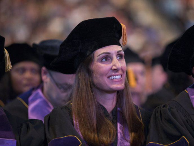 Doctoral graduates listen to commencement speeches