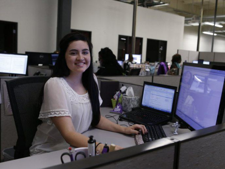 GCU Student worker sitting at desk working on computer