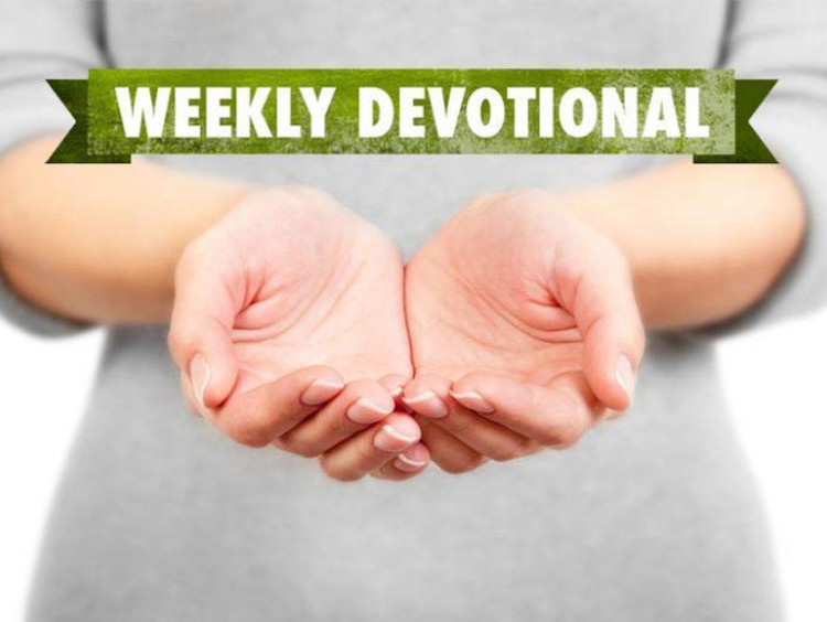 Open hands with weekly devotional text