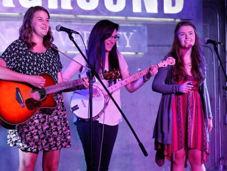 three girls playing instruments