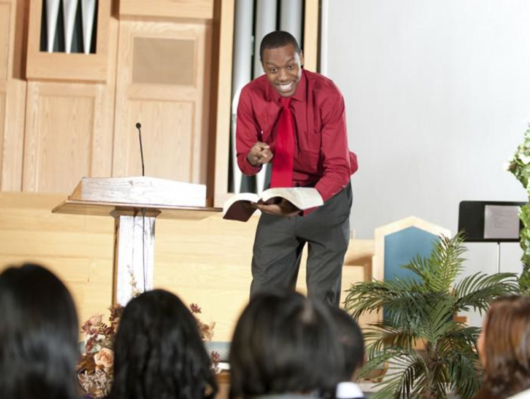 A pastor conducting a service at a church