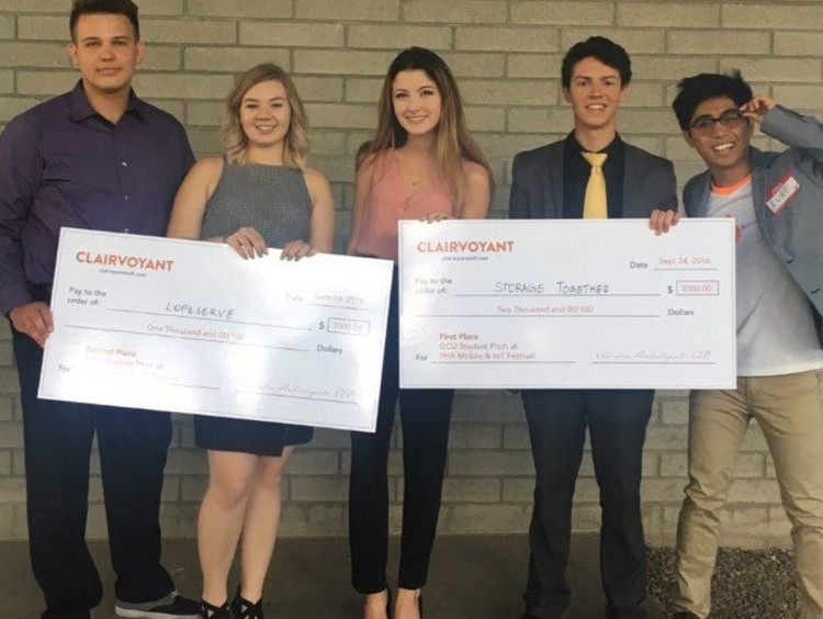 GCU honors students holding their prizes
