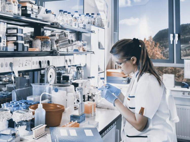 person working with chemicals in a lab