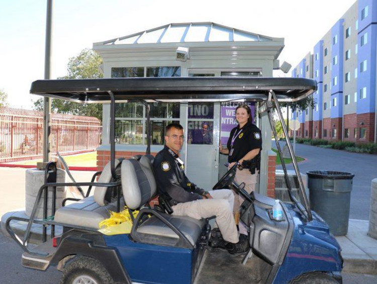 two public safety officers in a golf cart