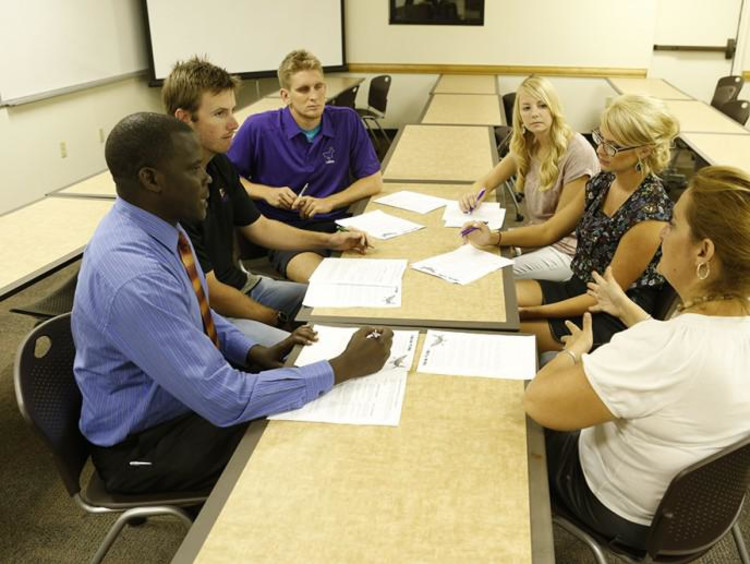 Young adults meet in conference room
