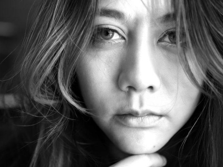 Close up in black and white of sad woman's face