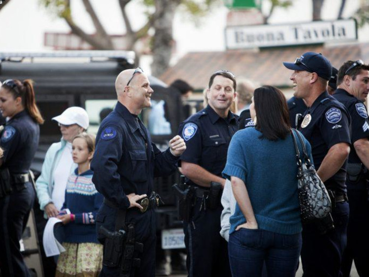 police officers talking to people