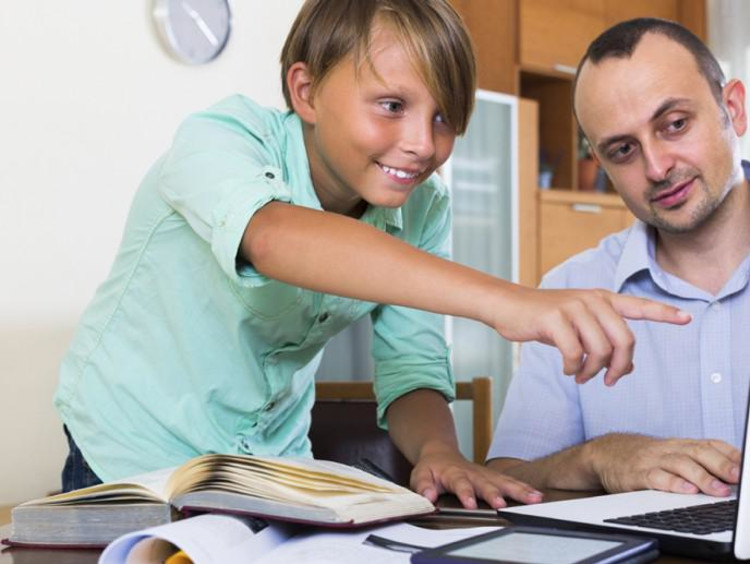 teacher helping gifted student
