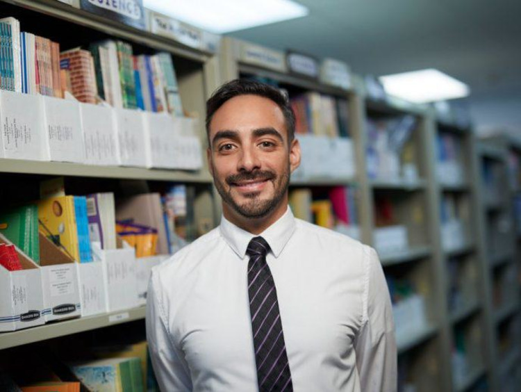 Headshot of Anthony Perez in library