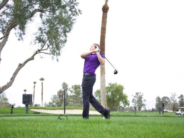 A student athlete playing golf
