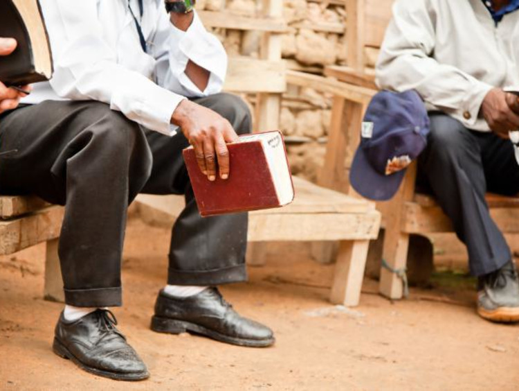 men having a bible study outside