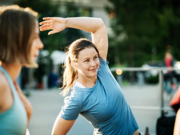 Women exercising in college
