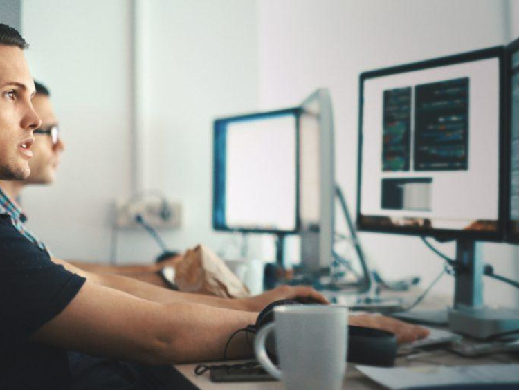 man working on computer