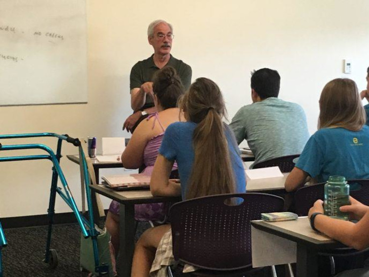 Dr. Val teaching a classroom full of students