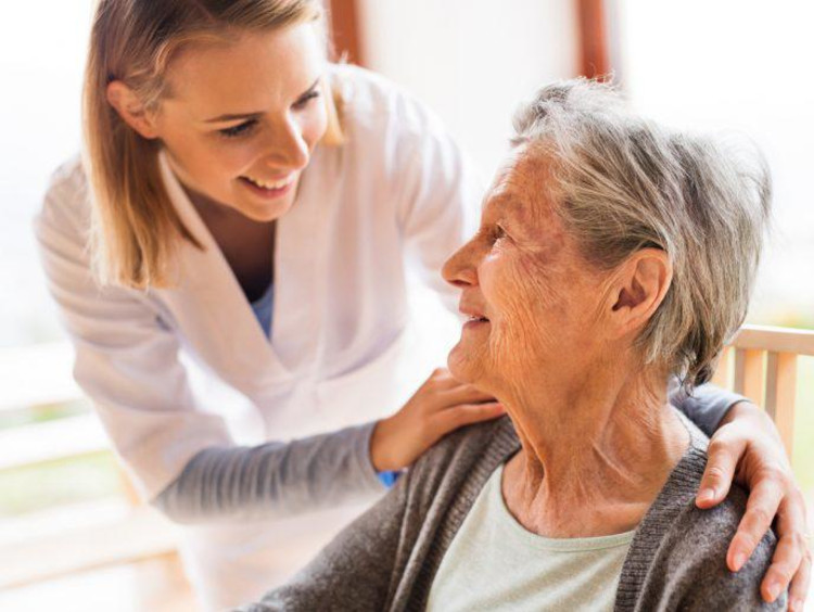 Health care administrator with elderly patient