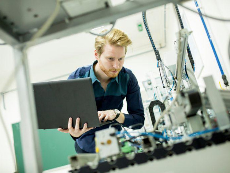 person holding computer