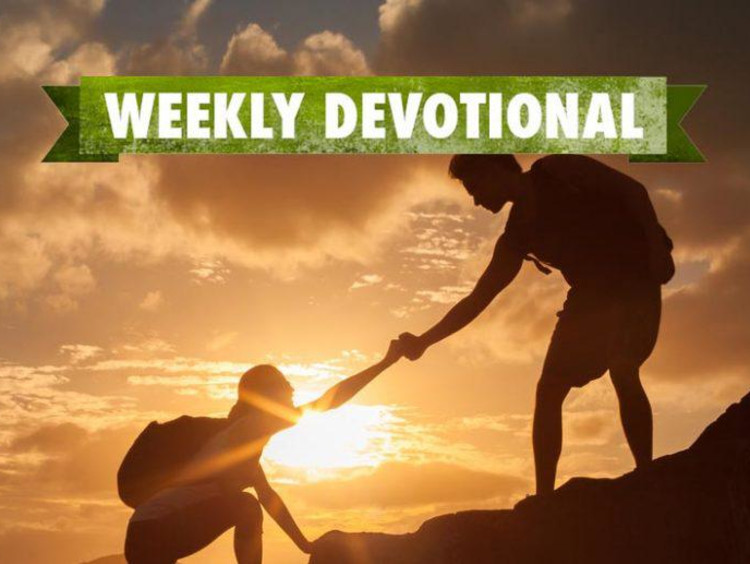 Weekly Devotional: One person helping another up a mountain