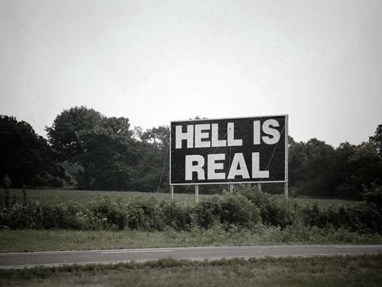 """sign that reads """"hell is real"""""""